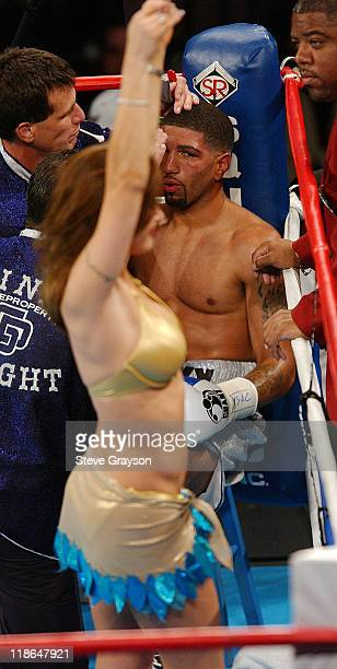 Winky Wright receives treatment from his corner while keeping an eye on a ring card girl between rounds during his bout against Angel Hernandez in...