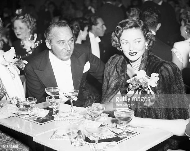 Winn Rockamona and actress Gene Tierney sitting at a table at the Metropolitan Opera in New York City November 11 1947