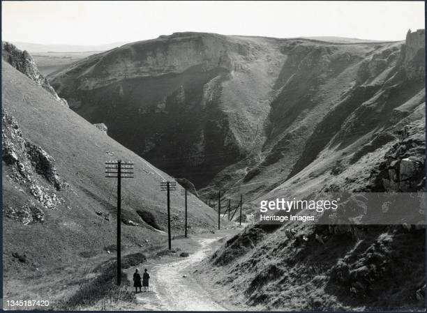 Winnats Pass, Castleton, High Peak, Derbyshire, 1930s. A couple standing at the head of Winnats Pass. In the early 1930s Winnats Pass was the site of...