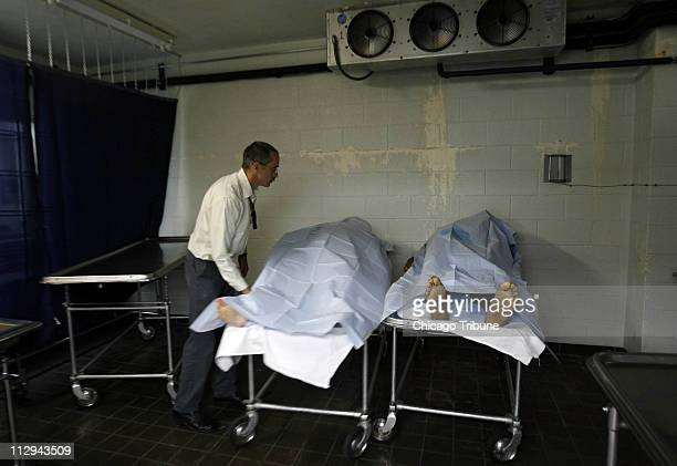 Winnebago County Deputy Coroner Mike Smirz places a body in the cororner's freezer after an autopsy in Rockford Illinois Tuesday October 2 2007...