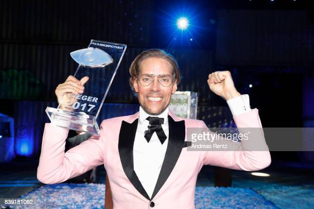 Winner 2017 Jens Hilbert poses with the award during the finals of 'Promi Big Brother 2017' at MMC Studio on August 25 2017 in Cologne Germany