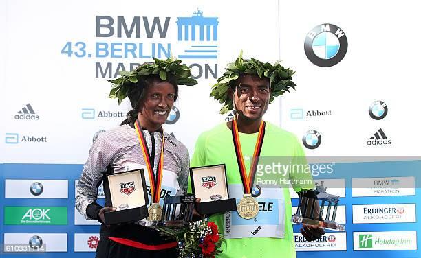 Winner Aberu Kebede and Kenenisa Bekele of Ethiopia pose during the medal ceremony after the 43rd BMW Berlin Marathon on September 25 2016 in Berlin...