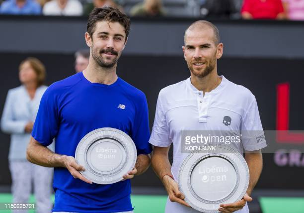 Winner Adrian Mannarino of France and Jordan Thompson of Australia pose with their trophies after their men's final match at the Libema Open tennis...