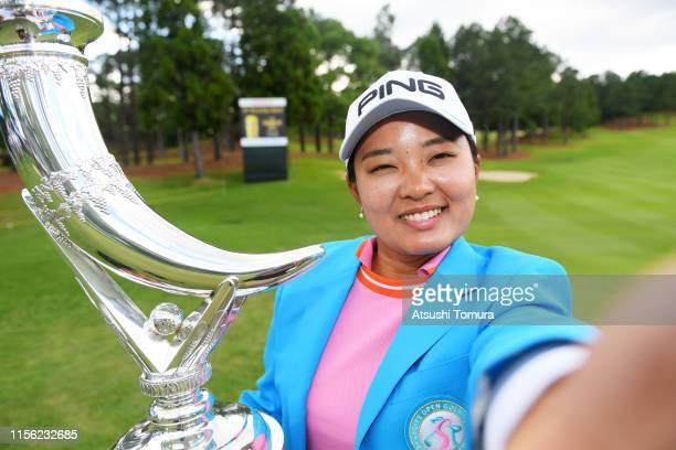 Winner Ai Suzuki of Japan imitates a selfie after the award ceremony following the final round of the Ai Miyazato Suntory Ladies Open Golf Tournament...