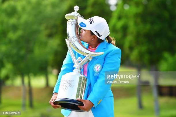 Winner Ai Suzuki of Japan kisses the trophy after the final round of the Ai Miyazato Suntory Ladies Open Golf Tournament at Rokko Kokusai Golf Club...