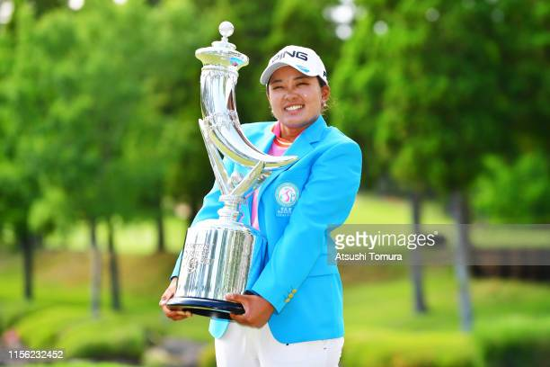 Winner Ai Suzuki of Japan poses for photographs with the trophy during the award ceremony following the final round of the Ai Miyazato Suntory Ladies...