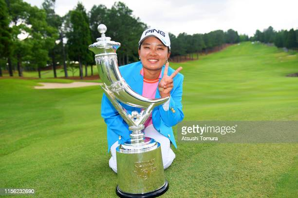 Winner Ai Suzuki of Japan poses with the trophy after the award ceremony following the final round of the Ai Miyazato Suntory Ladies Open Golf...