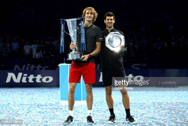 Winner Alexander Zverev of Germany and runner up Novak Djokovic of Serbia pose with their trophies following the singles final during Day Eight of...