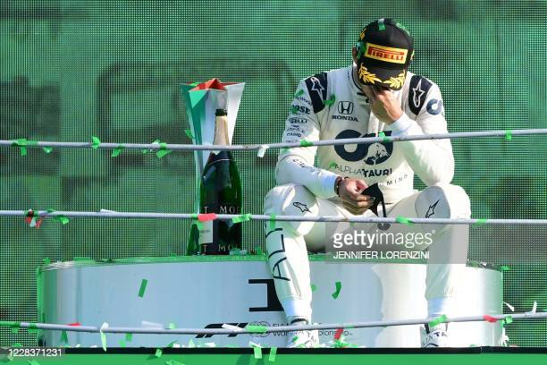 Winner AlphaTauri's French driver Pierre Gasly celebrates on the podium after the Italian Formula One Grand Prix at the Autodromo Nazionale circuit...
