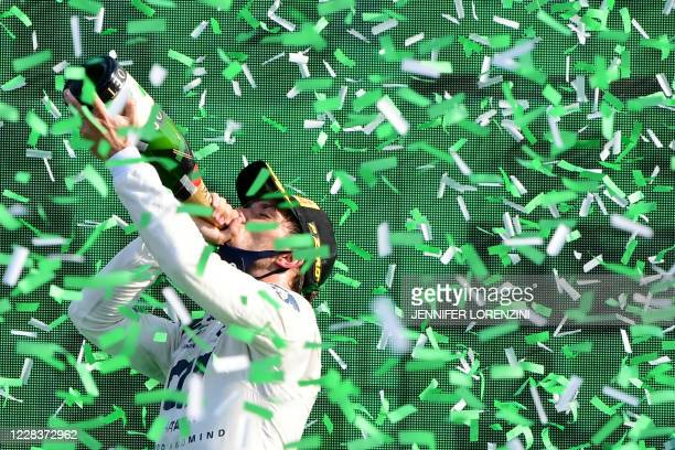 TOPSHOT Winner AlphaTauri's French driver Pierre Gasly drinks champagne on the podium after the Italian Formula One Grand Prix at the Autodromo...