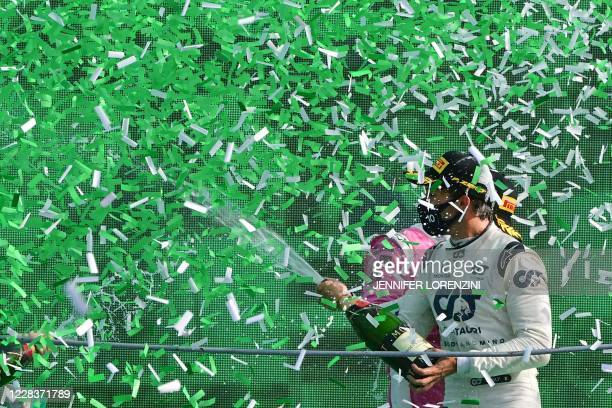 Winner AlphaTauri's French driver Pierre Gasly sprays champagne under confetti rain on the podium after the Italian Formula One Grand Prix at the...