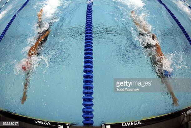 Winner Amanda Weir out-touches 2nd place finisher Victoria Poon of Canada during the championship final of the 50 meter freestyle at the...