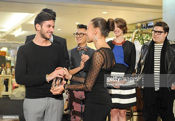 Winner and FIDM Fashion Design Student Ali Jawad receives his award at Westfield Style Hosts Cocktails Couture at Westfield Topanga on November 13...