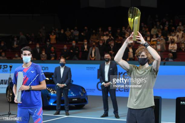 Winner Andrey Rublev of Russia and second placed Lorenzo Sonego of Italy pose with their trophies after their final match on day nine of the Erste...