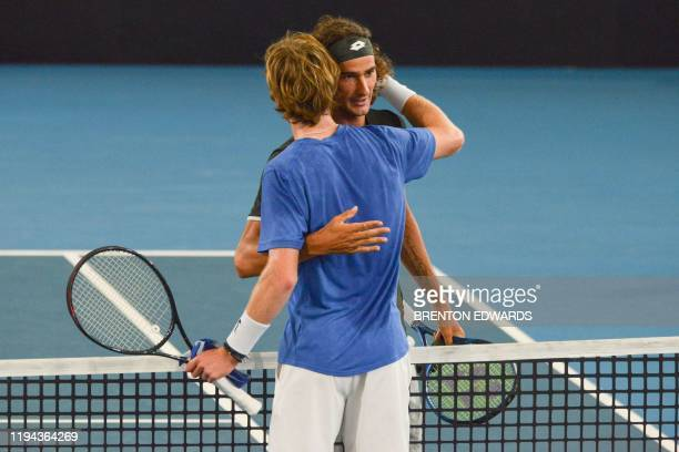 Winner Andrey Rublev of Russia is congratulated by Lloyd Harris of South Africa in their men's final singles match at the Adelaide International...