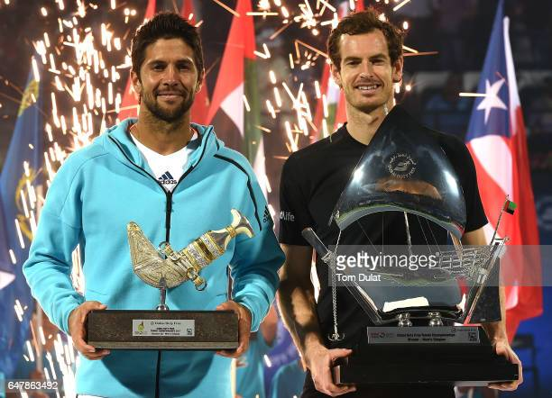 Winner Andy Murray of Great Britain and runner up Fernando Verdasco of Spain pose with the trophies after their final match on day seven of the ATP...