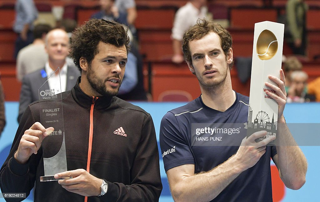 Winner Andy Murray of Great Britain (R) poses after the final match against Jo-Wilfried Tsonga of France (L) at the ATP Erste Bank Open Tennis tournament in Vienna, on October 30, 2016. / AFP / APA / HANS PUNZ / Austria OUT