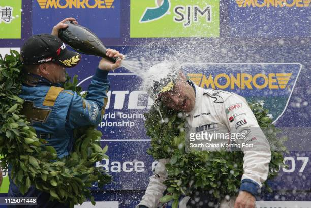Winner Andy Priaulx and first runner-up Nicola Larini of FIA World Touring Car Championship Race Classification- Race 2, spurting champagine to...