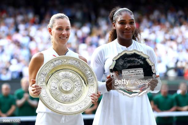 Winner Angelique Kerber of Germany and runnerup Serena Williams of The United States pose with the trophies after the Ladies' Singles final on day...