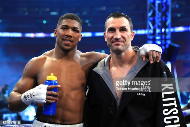 Winner Anthony Joshua stands with Wladimir Klitschko following the IBF WBA and IBO Heavyweight World Title bout at Wembley Stadium on April 29 2017...
