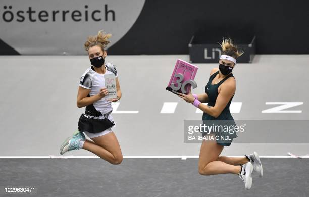 Winner Aryna Sabalenka from Belarus and second placed Belgium's Elise Mertens pose during the awards ceremony after the final match of the WTA Upper...