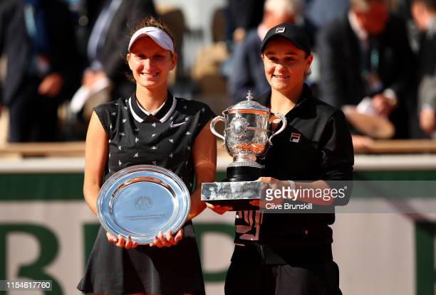 Winner Ashleigh Barty of Australia and runner up Marketa Vondrousova of The Czech Republic pose with their trophies following the ladies singles...