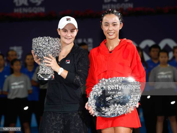 Winner Ashleigh Barty of Australia and runner up Wang Qiang of China pose with their trophies after the Women's Single final match on Day 6 of 2018...