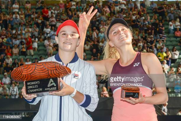 Winner Ashleigh Barty of Australia and runnerup Dayana Yastremska of Ukraine pose after their women's final singles match at the Adelaide...