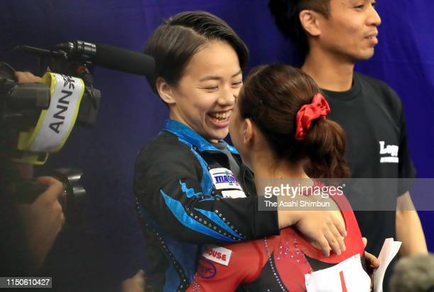 Winner Asuka Teramoto is congratulated by Mai Murakami on day one of the Artistic Gymnastics NHK Trophy at Musashino Forest Sport Plaza on May 18...