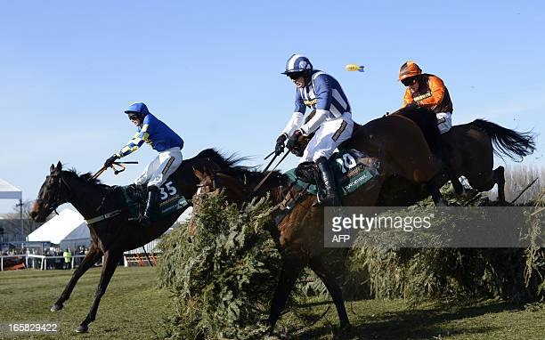 Winner Auroras Encore ridden by Ryan Mania and Teaforthree ridden by Nick Scholfield take a jump during the Grand National horse race at Aintree...