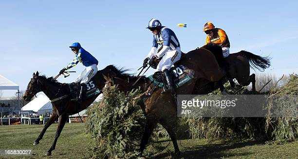 Winner Auroras Encore ridden by Ryan Mania and Teaforthree ridden by Nick Scholfield jump the last fence during the Grand National horse race at...