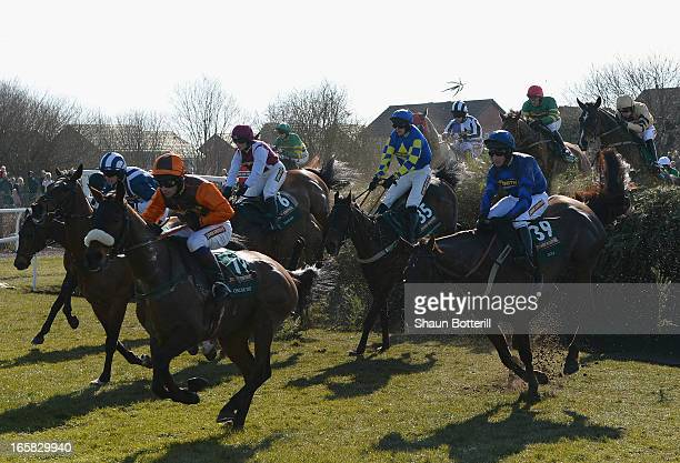 Winner Auroras Encore riden by Ryan Mania clears Becher's Brook during the John Smith's Grand National Steeple Chase at Aintree Racecourse on April...