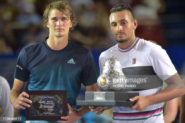 Winner Australian tennis player Nick Kyrgios and German tennis player Alexander Zverev hold their trophies after the Mexico ATP Open men's singles...