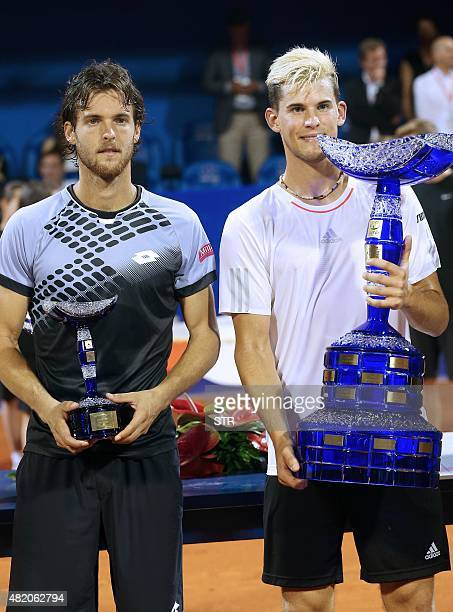 Winner Austrian player Dominic Thiem and Portuguese player Joao Sousa hold their trophy after the ATP Croatia Open tennis tournament final match on...