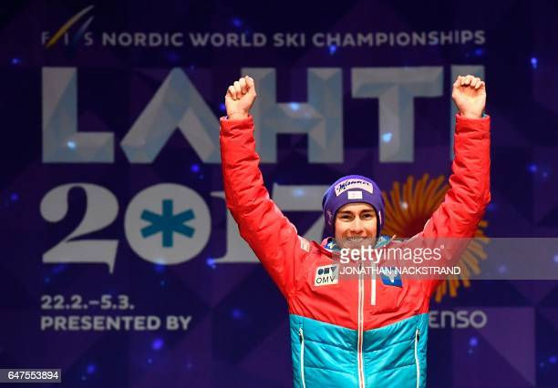 Winner Austrian Stefan Kraft celebrate during the medals ceremony for the men large hill individual ski jumping competition of the FIS Nordic Ski...