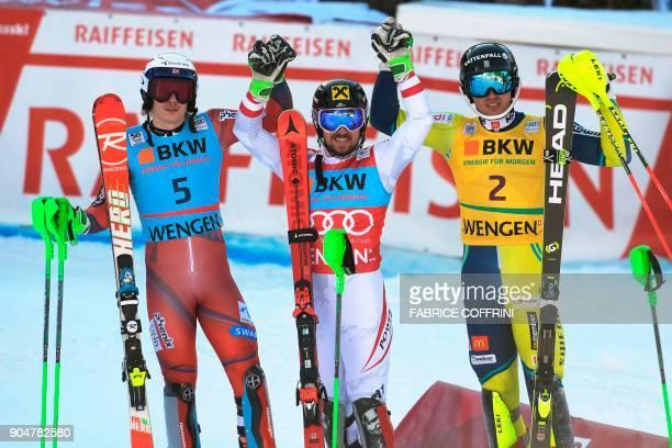 Winner Austria's Marcel Hirscher secondplaced Norway's Henrik Kristoffersen and thirdplaced Sweden's Andre Myhrer celebrate after the men's Slalom...