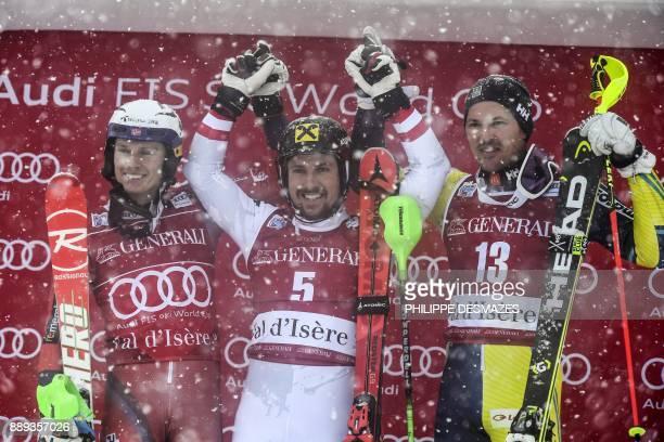 Winner Austria's Marcel Hirscher secondplaced Norway's Henrik Kristoffersen thirdplaced Sweden's Andre Myhrer celebrate on the podium of the FIS...