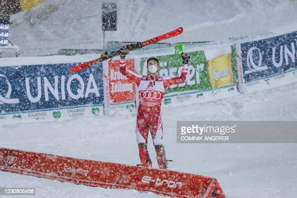 Winner Austria's Marco Schwarz reacts after the second run of the men's Slalom event at the FIS Alpine Ski World Cup in Schladming, Austria on...