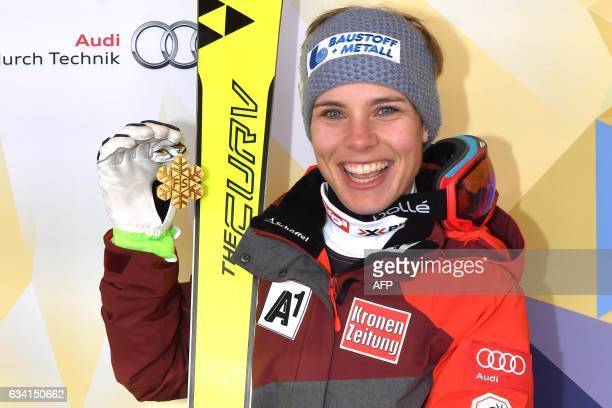 Winner Austria's Nicole Schmidhofer poses with her medal after the podium ceremony of the women's SuperG race at the 2017 FIS Alpine World Ski...