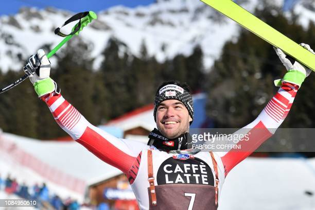 Winner Austria's Vincent Kriechmayr celebrates ahead of the podium ceremony after competing in the Men's Downhill of the Lauberhorn during the FIS...