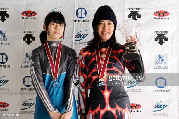 Winner Aya Yasuda and runnerup Yuki Ishikawa pose on the podium for the Women's Single Luge during the All Japan Skeleton And Luge Championships at...