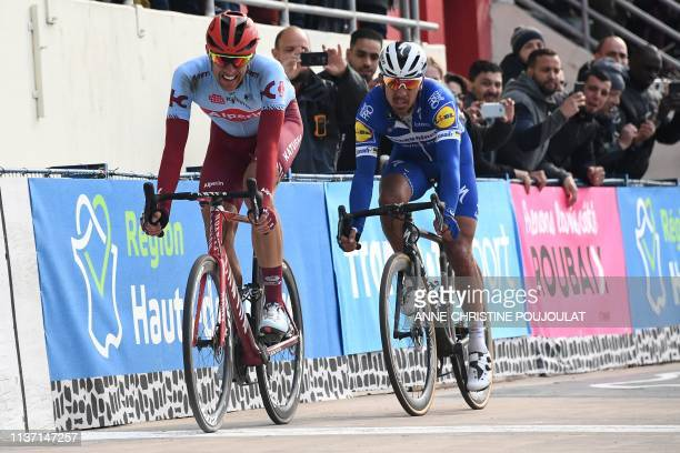 Winner Belgium's Philippe Gilbert and second-placed Germany's Nils Politt slow down before the final sprint of the 117th edition of the Paris-Roubaix...