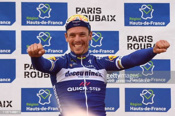 Winner Belgium's Philippe Gilbert celebrates his victory on the podium of the 117th edition of the ParisRoubaix oneday classic cycling race between...