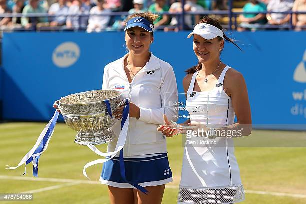 Winner Belinda Bencic of Switzerland and runner up Agnieszka Radwanska of Poland pose with their trophies on day seven of the Aegon International at...