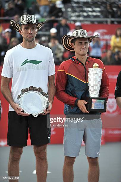 Winner Bernard Tomic of Australia , and second place Ivo Karlovic of Croatia pose for a photo during a tennis match between Bernard Tomic of...