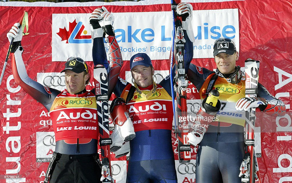 Winner Bode Miller (C) of the US celebrates with second placed Hermann Maier (L) of Austria and third placed Michael Walchhofer (R) of Austria after their run on the Men's Super-G course 28 November 2004 at the Lake Louise Ski Resort in Lake Louise, Canada. Miller took first with a time of 1:28.18 in the event.