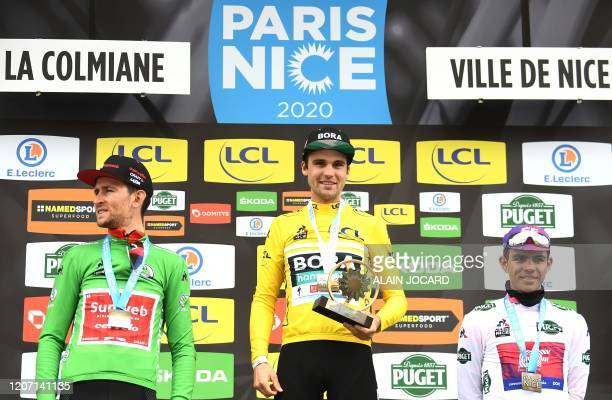 Winner, BORA - hansgrohe German rider Maximilian Schachmann celebrates his overall leader yellow jersey on the podium with second placed Team Sunweb...