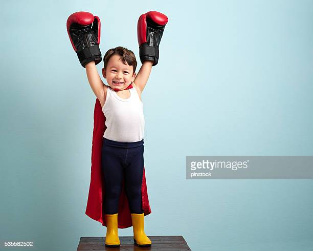 winner boxer child raising his hands with victory - boxing gloves stock photos and pictures