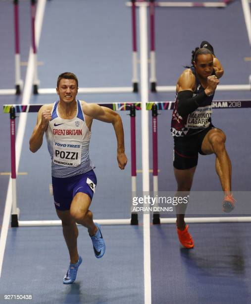 Winner Britain's Andrew Pozzi and France's Pascal MartinotLagarde compete in the men's 60m hurdles final at the 2018 IAAF World Indoor Athletics...