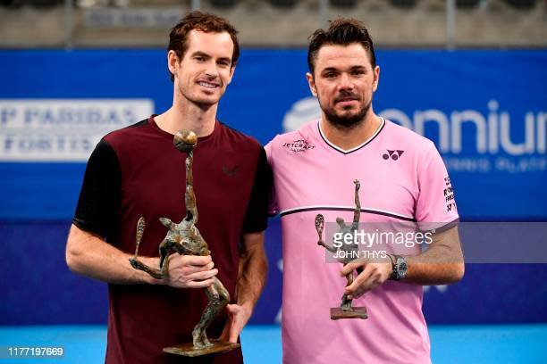 Winner Britain's Andy Murray and secondplaced Switzerland's Stanislas Wawrinka celebrate with their trophies after competing in their men's single...